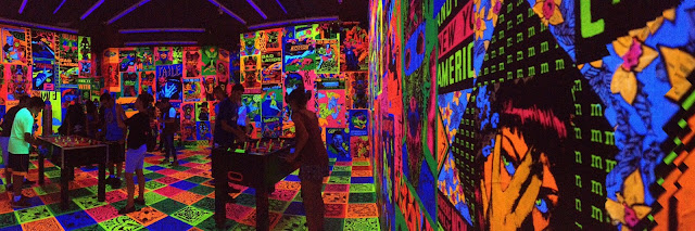 Faile blacklight and foosball art at Brooklyn Museum