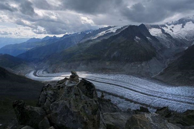 The Aletsch Glacier is pictured from the Eggishorn summit in Fiesch, Switzerland, 22 August 2015. One of Europe's biggest glaciers, the Great Aletsch coils 23 km (14 miles) through the Swiss Alps - and yet this mighty river of ice could almost vanish in the lifetimes of people born today because of climate change. The glacier, 900 meters (2,950 feet) thick at one point, has retreated about 3 km (1.9 miles) since 1870 and that pace is quickening. Photo: Denis Balibouse / REUTERS
