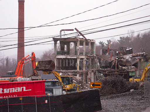 A machine eagerly awaits to be filled with more rubble.