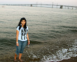 Fialka Grigorova on the beach at Sandy Point State Park, with the Chesapeake Bay Bridge in the background, on the Chesapeake Bay near Annapolis.