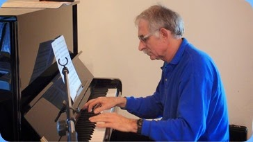 Claude Moffat playing the piano. Photo courtesy of Dennis Lyons.