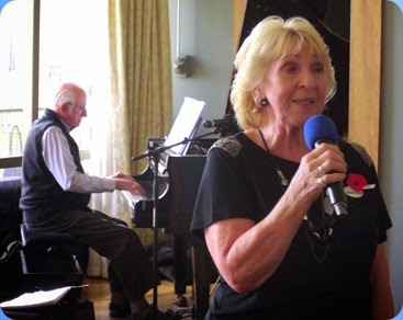 Margaret Black, our lovely host for the day, sang for us and accompanied by Rob Powell on the Kawai mini--grand piano.