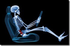Lower back pain (red) caused by an improper sitting position while driving. This X-ray shows the bones of the lower back to be curved rather than straight. Lower back pain (lumbago) is extremely common, affecting most people at some point in their lives. Poor posture is one of the major risk factors.