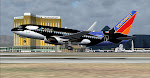 Mandalay Bay and Luxor supply the background as Shamu takes to the skies off runway 19L