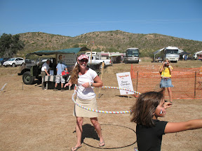 Mary gives the hula-hoop a try.