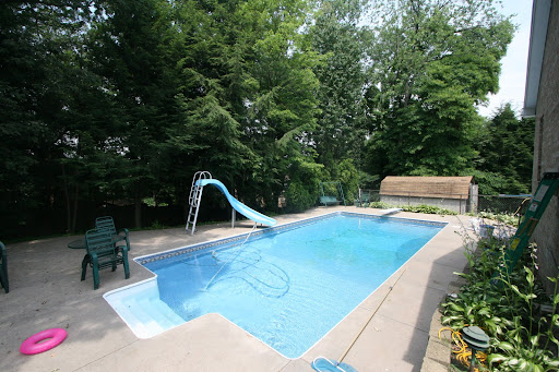 36x18 in-ground heated Pool with over-sized pool deck, invisible fence, retaining walls, above ground fencing, and lighting and electrical.