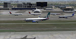 Traffic waits to takeoff from runway 25R as this AirTran 73G settles in for 25L at LAX