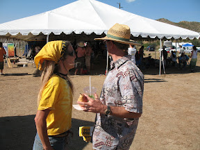 """Kathleen and Bill Powers with """"Save Anza Borrego"""" bumper stickers in hand."""