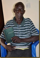 Pastor Nzuala with Bible - Kazumba