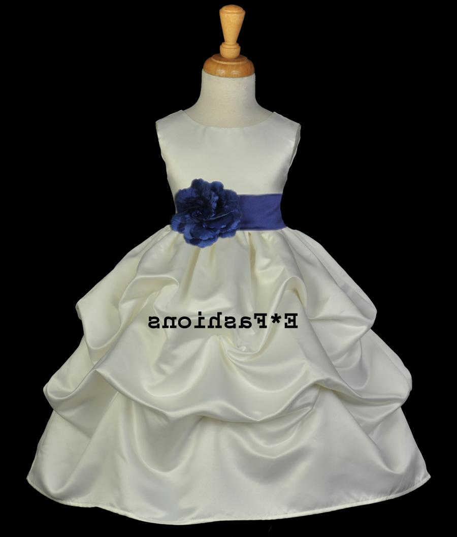 Color: Ivory   with Removable Navy Blue Tiebow sash with flower