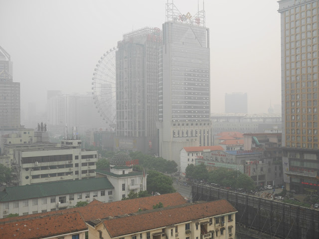 a smoggy view of Furong Middle Road in Changsha