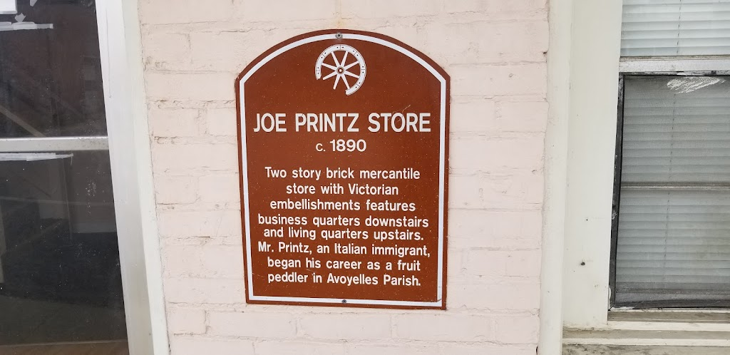 Two story brick mercantile store with Victorian embellishments features business quarters downstairs and living quarters upstairs. Mr. Printz, an Italian immigrant, began his career as a fruit ...