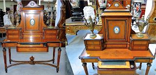 Красивый письменный кабинет. 19-й век. Палисандр, бронзовый орнамент, фарфоровые вставки. Выдвижной ящик с принадлежностями для письма. 127/47/155 см. 5600 евро.