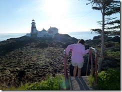 Tricia going down the scary stairs at East Quoddy Head Light