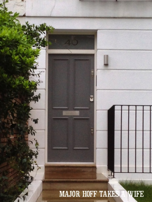 Replace classic black door color with gray. Looking for painting ideas? About to pick a front door color? Be inspired by these doors found in London. From classic to bold, there is sure to be a color that suits you! #color #inspiration #London #FrontDoor #paintingideas