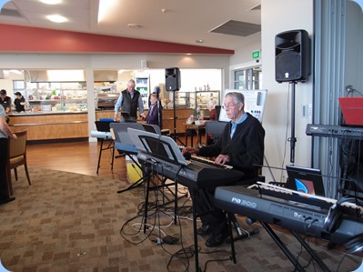 Michael Bramley playing a Yamaha PSR-S950 and some of the members keyboards lined-up!  Photo courtesy of Diane Lyons.