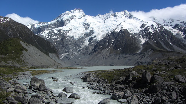 A milky glacial lake and snow-capped mountain range on the Hooker Valley walk.
