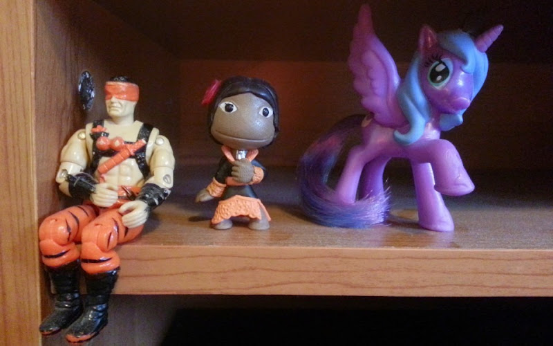 Desk figurines of a G.I. Joe, a Sackboy from Little Big Planet, and Luna from My Little Pony