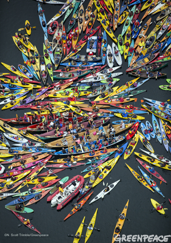 Aerial view of 'kayaktivists' in kayaks, who are protesting Shell's huge Arctic drilling rig, the Polar Pioneer, on 16 May 2015. Photo: N. Scott Trimble / Greenpeace USA