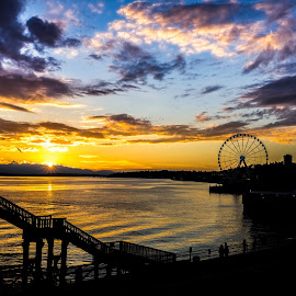 Seattle Sunset by Gary Piazza - Landscapes Sunsets & Sunrises ( clouds, sony, sky, seattle, silhouette, sunset, pier, boardwalk, sun, ferris wheel, city, golden hour )