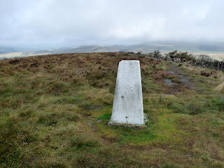 We reach the Trig Pillar at Burbage Edge