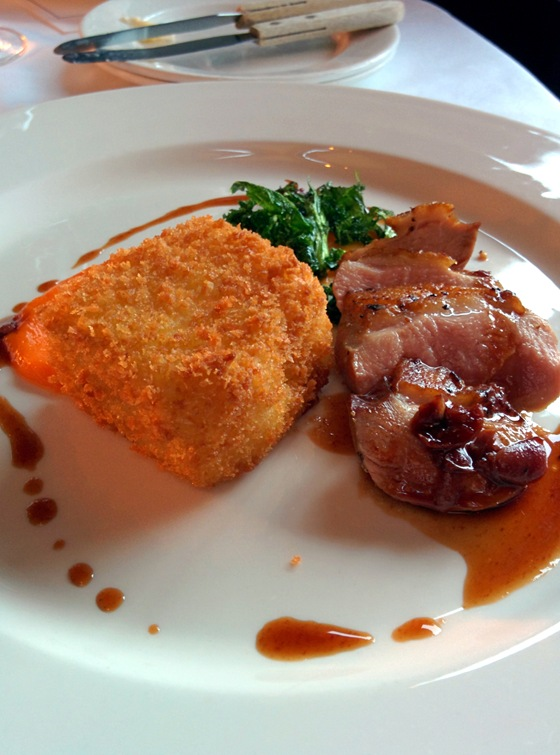 Duck Breast with Sour Cherry Sauce, Potato Croquette, Crispy Kale, and Carrot Puree