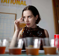 """Marnie Old sniffs a Belgian style beer. ( David Swanson / Staff Photographer ) Inquirer Photo Studio, Philadelphia, PA 05-24-2011 FD1BREW02 Our Second Annual Local Beer Survey Competition!! Our panel of beer experts sits down again to blind-taste through the best beers Philadelphia has to offer in the Inquirer's Second Annual Local Brew-vitational. We'll need to shoot each of the judges (photo as well as sit-down video), and also document the tasting event through to it sud-soaked finale where we crown the Top 6 pack of three best new beers, and three best """"classics"""". We have a lot of pre-shot jpegs coming in from the breweries, but will need to do some """"product shots"""" of the stragglers, especially the cold growlers, on the day-of, preceding the competition, so that we have an image of every beer."""