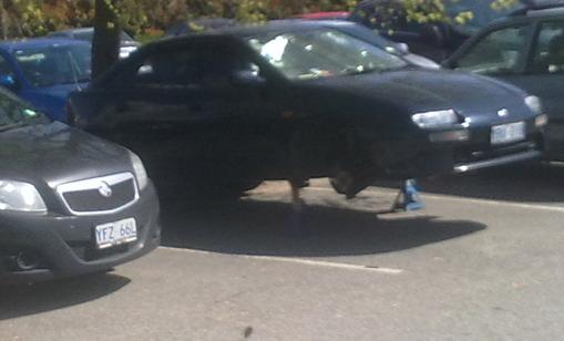 jacked up car