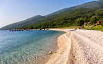The only beach in Karaburun peninsula which is commercialized during peak season