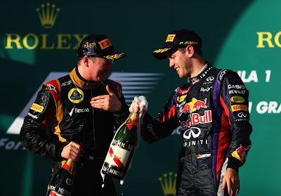 Кими Райкконен и Себастьян Феттель с шампанским на подиуме Гран-при Австралии 2013