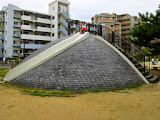 The slide in the park across the street from the Fukuoka International School