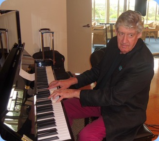 Ian Jackson playing the Wertheim piano. Photo courtesy of Delyse Whorwood.