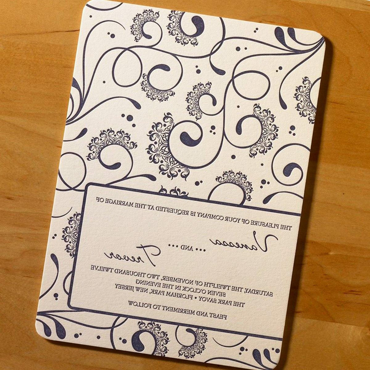 This impressive letterpress wedding invitation features vivacious swirls