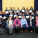 Students who took part in a creative writing group at the Mulroy College Junior Prize Giving with seated Karen Patton, Teacher, Denise Blake, Writer and Class Tutor, Shaun McFadden, Guest Speaker, Fiona Temple, Principal and Catherine McHugh, Vice Principal.  Photo:- Clive Wasson