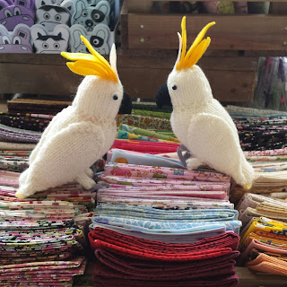 Knitted cockatoos from a pattern by Nicky Fijalkowska