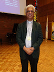 2015 Convention Pastor Peter Deebrah wearing the commemorative medal struck for St. Matthew NYC 350 Anniversary.jpg