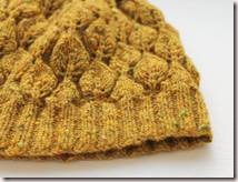 Hand knitted honey brown lace hat