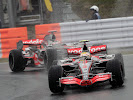 Lewis Hamilton & Fernando Alonso driving the McLaren MP4-22