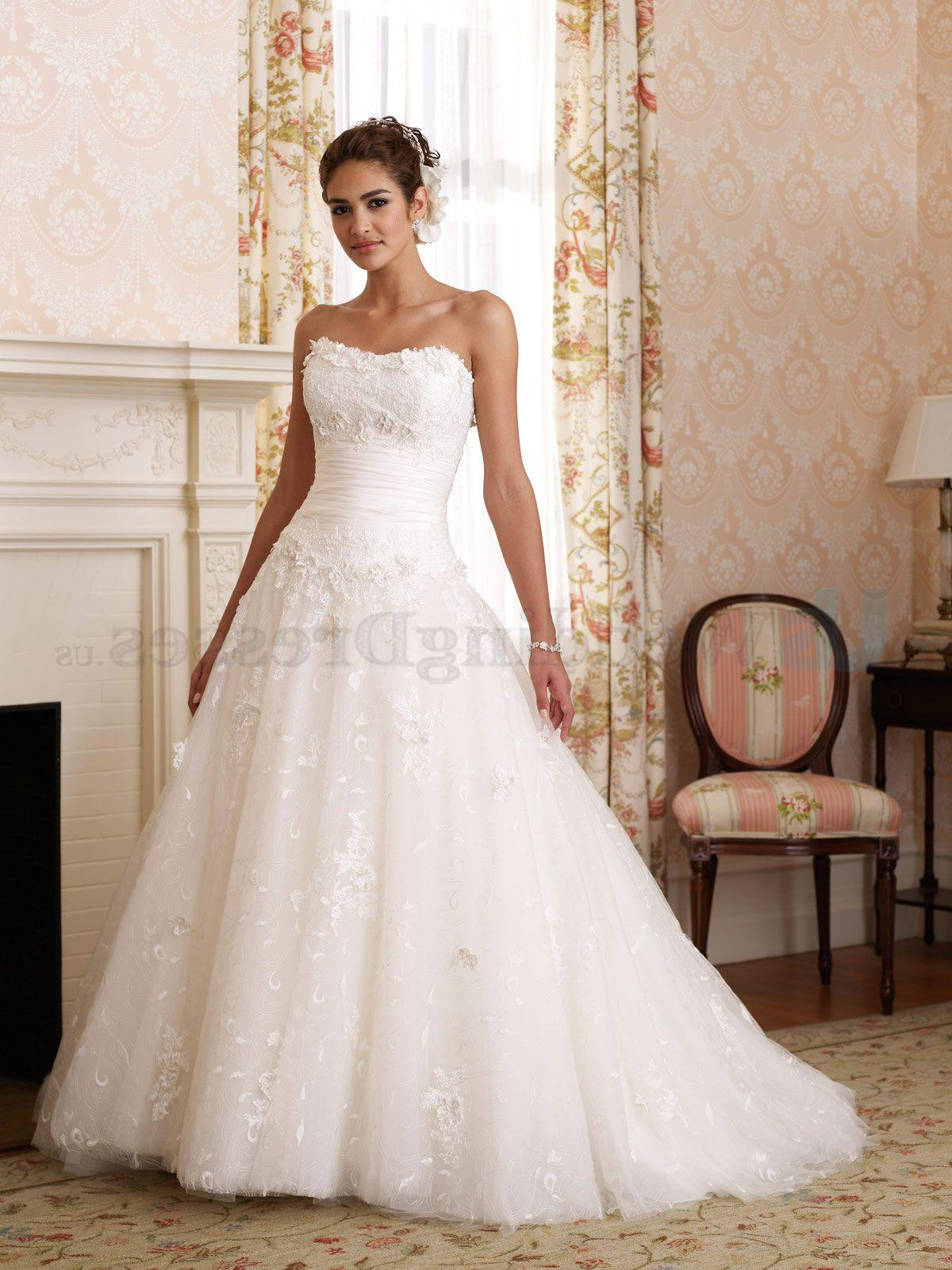 Strapless all-over lace and taffeta Ball Gown, softly curved neckline,