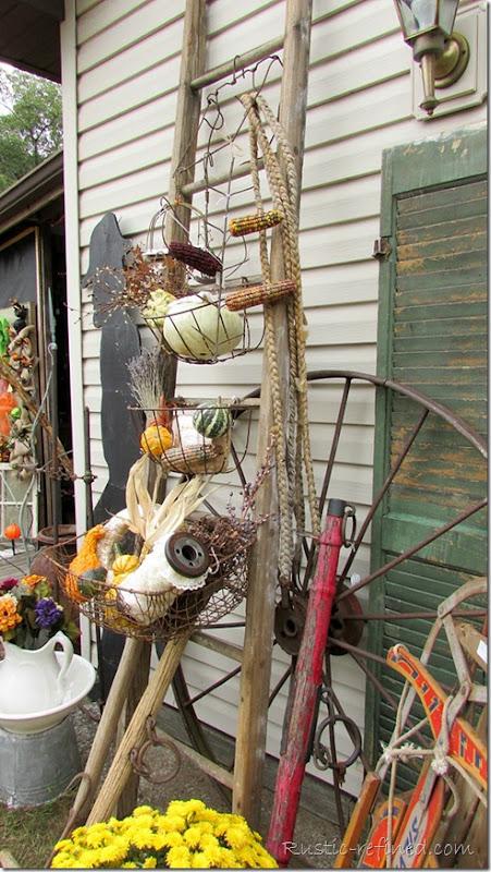 Salvage antique ladder and wire baskets