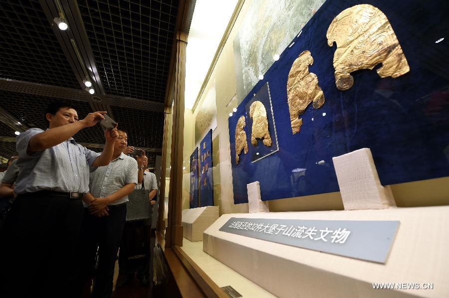 France returns looted gold antiquities to China