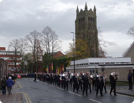 The parade passes close to Christ Church Tower