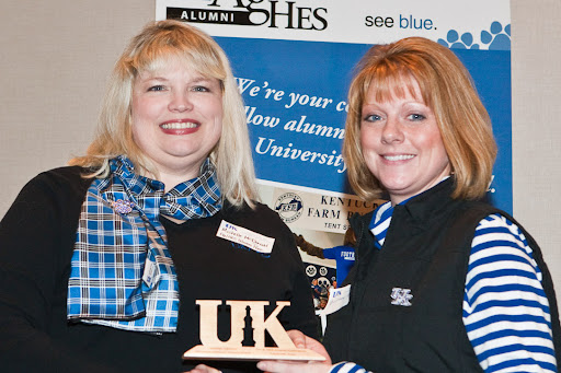 Brittany Edelson (right) from Shelbyville, KY in the Louisville area received a New Achiever Award from Michelle McDonald, alumni association president, at the UK Ag & HES Alumni 31st Annual Winter Event held January 9, 2010 at the Downtown Lexington Hyatt Patterson Ballroon in Lexington, Kentucky