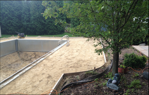 A nice curve to this custom inground pool, it surely got a heater, automatic cleaner, and some other great swimming pool upgrades and accessories!  Utica, MI is just one of the cities we service, we'll help you out in any of the cities in Macomb and Oakland County!  Thanks for everything