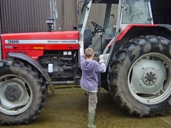 child-climbing-into-tractor