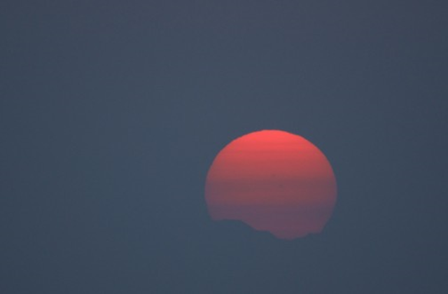 Viewed from West Seattle, this sunset is obscured by smoke from forest fires on 8 July 2015. Photo: Jamie Kinney
