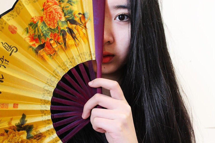 Sometimes its not what you see that's important, it's the hidden meaning behind it. by Cindy Cheung - People Portraits of Women ( girl, female, head shot, women, fan, portrait, chinese, asian )