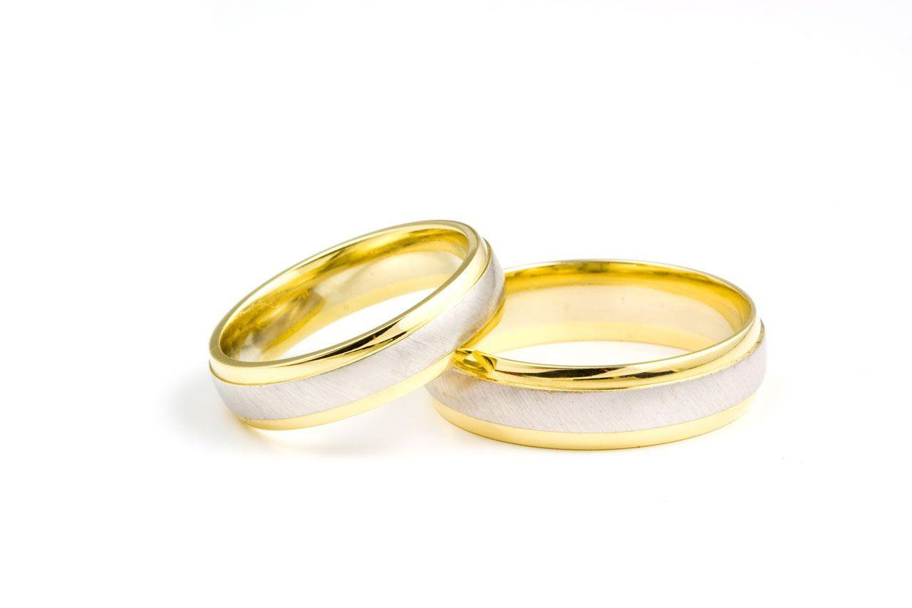 golden wedding rings on white