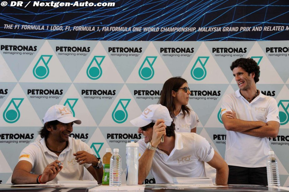 Нараин Картикеян и Педро де ла Роса на автограф-сессии на Гран-при Малайзии 2012