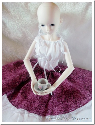 bjd drinking tea in red and off-white skirt